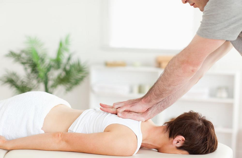 Woman getting a chiropractic adjustment.