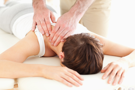 Woman getting chiropractic care.
